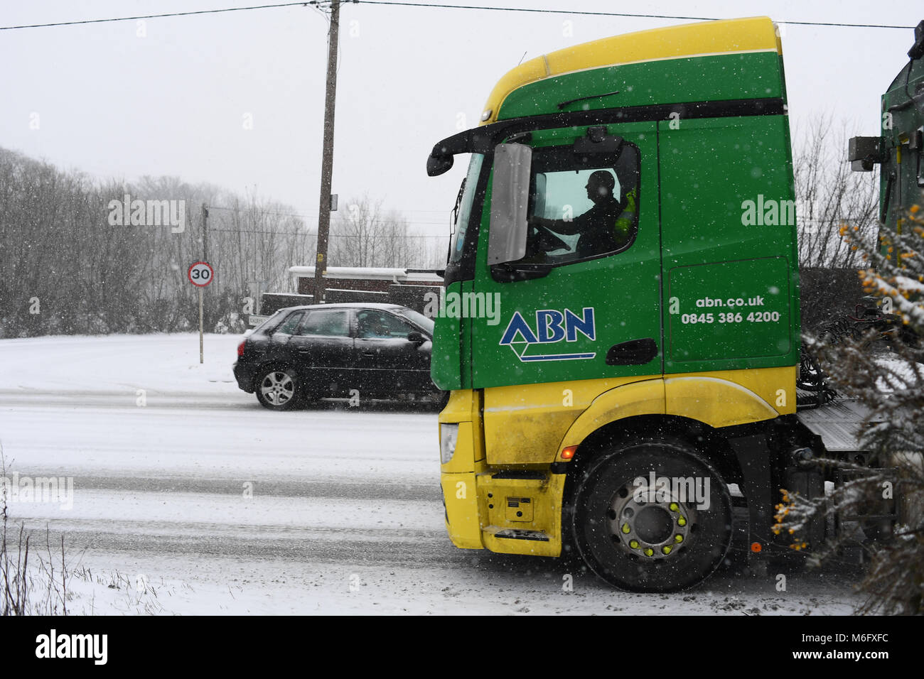 ABN truck driving in the snow delivering farm produce towards Salisbury on the A36 in treacherous conditions . - Stock Image