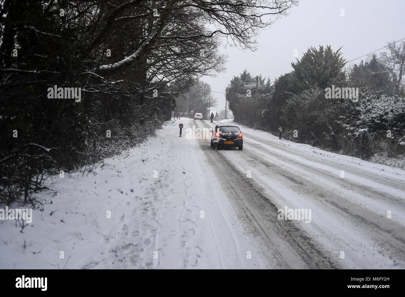 Cars struggle to get up the hills on the A36 towards Southampton UK during the freak snow storms in March 2018. - Stock Image