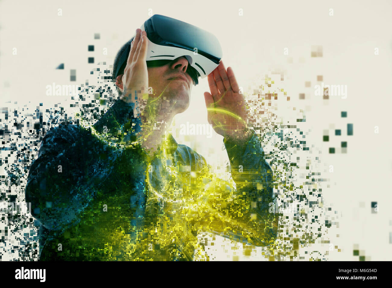 A person in virtual glasses flies to pixels. The man with glasses of virtual reality. Future technology concept. - Stock Image