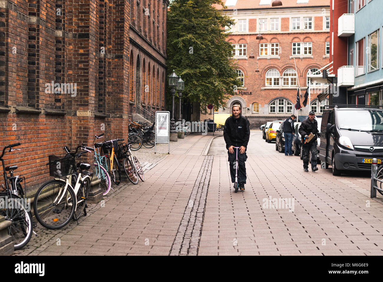 Copenhagen - October 17, 2016: A man with his tricycle on the Norregade street. Stock Photo