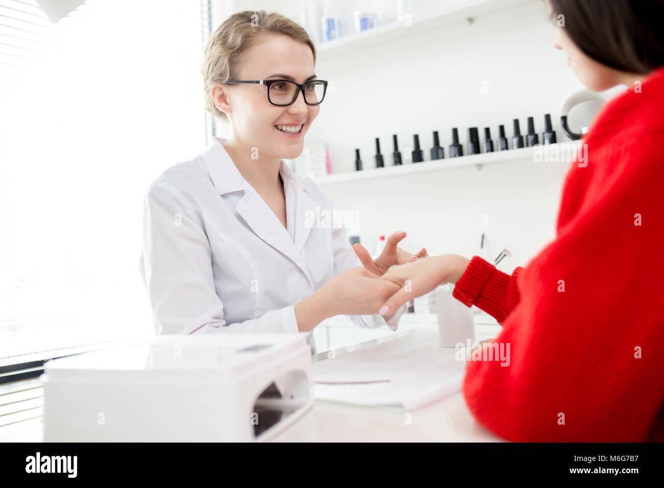 Enjoying Procedure at Nail Salon - Stock Image