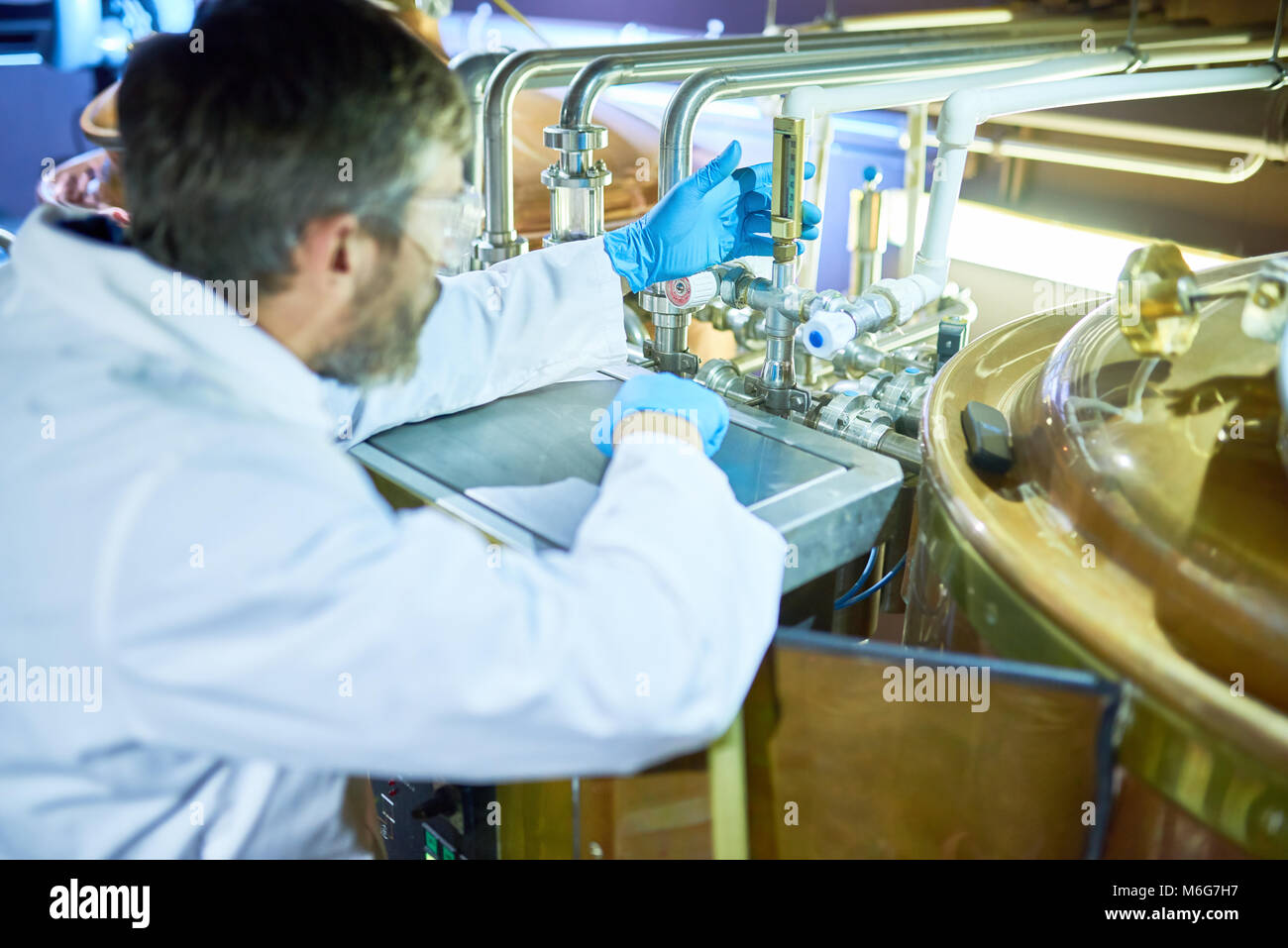 Bearded Technician Focused on Work - Stock Image