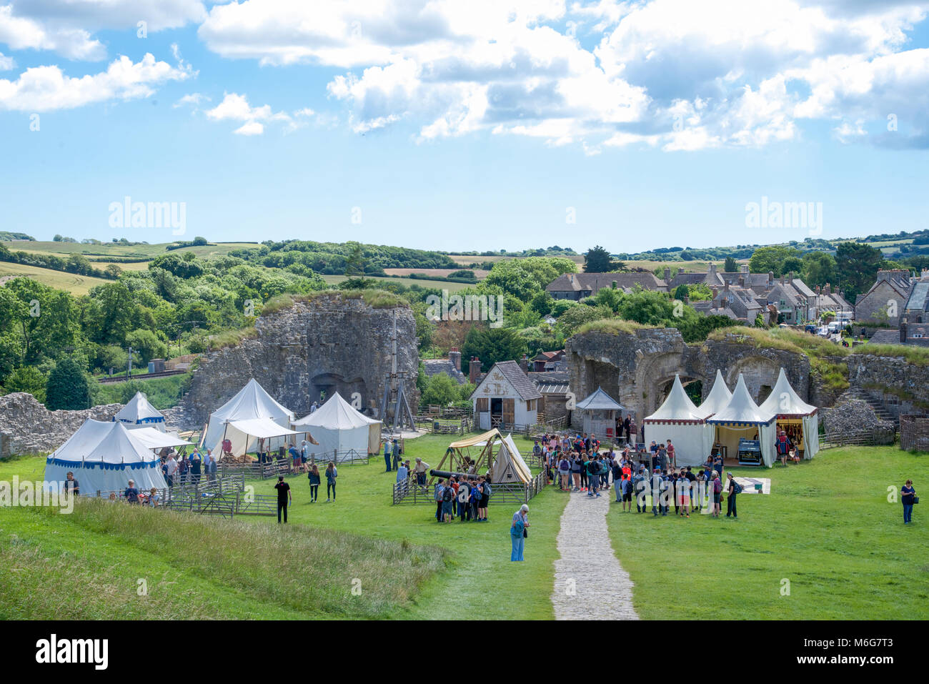 Mediaeval fair set up in the grounds of Corfe Castle, Purbeck Hills, Dorset, England - Stock Image