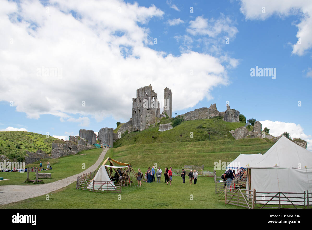A mediaeval fair in the grounds of Corfe Castle, Dorset, England - Stock Image