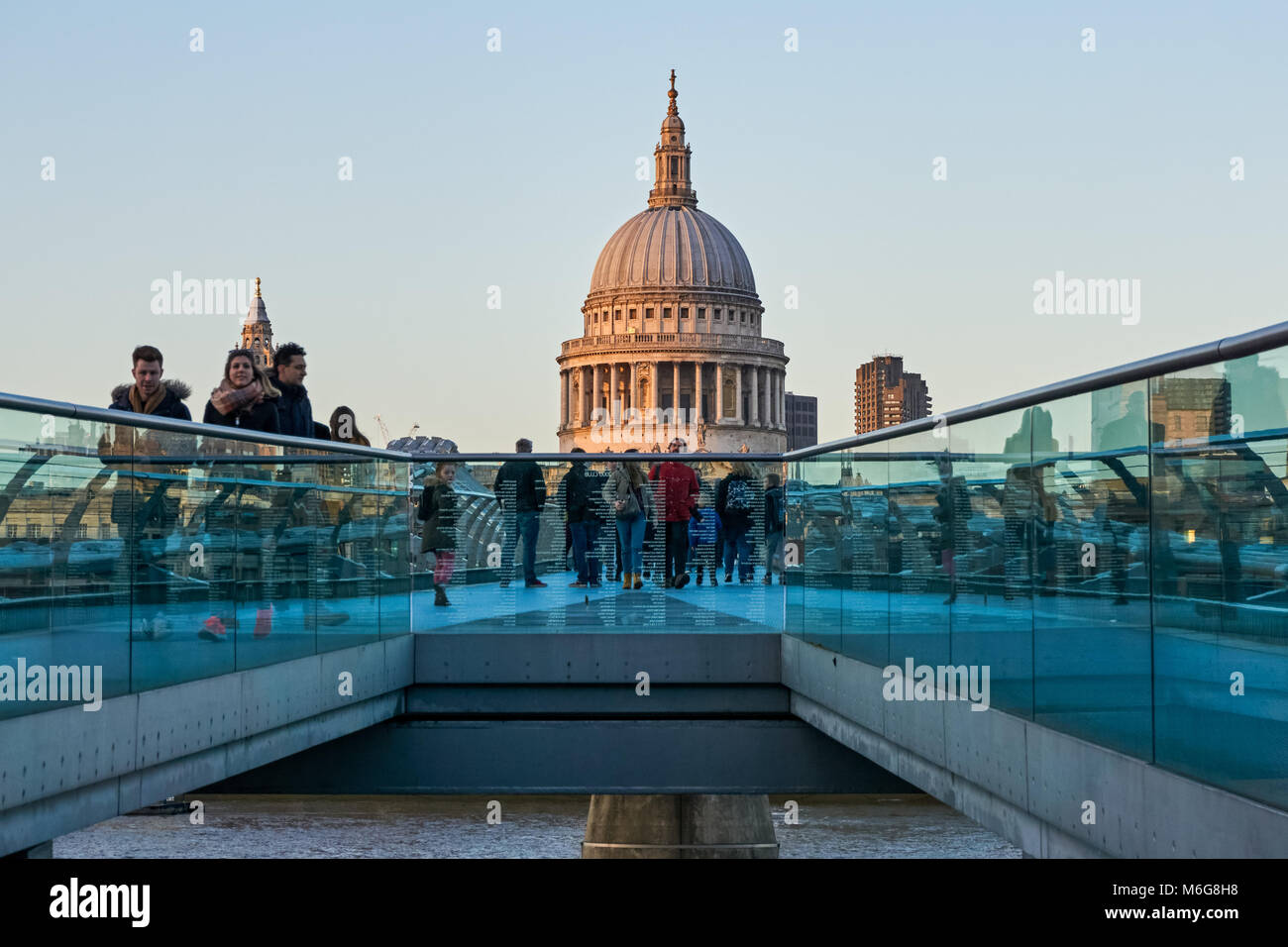 People on the Millennium Bridge with St Paul's Cathedral in the background, London England United Kingdom UK - Stock Image
