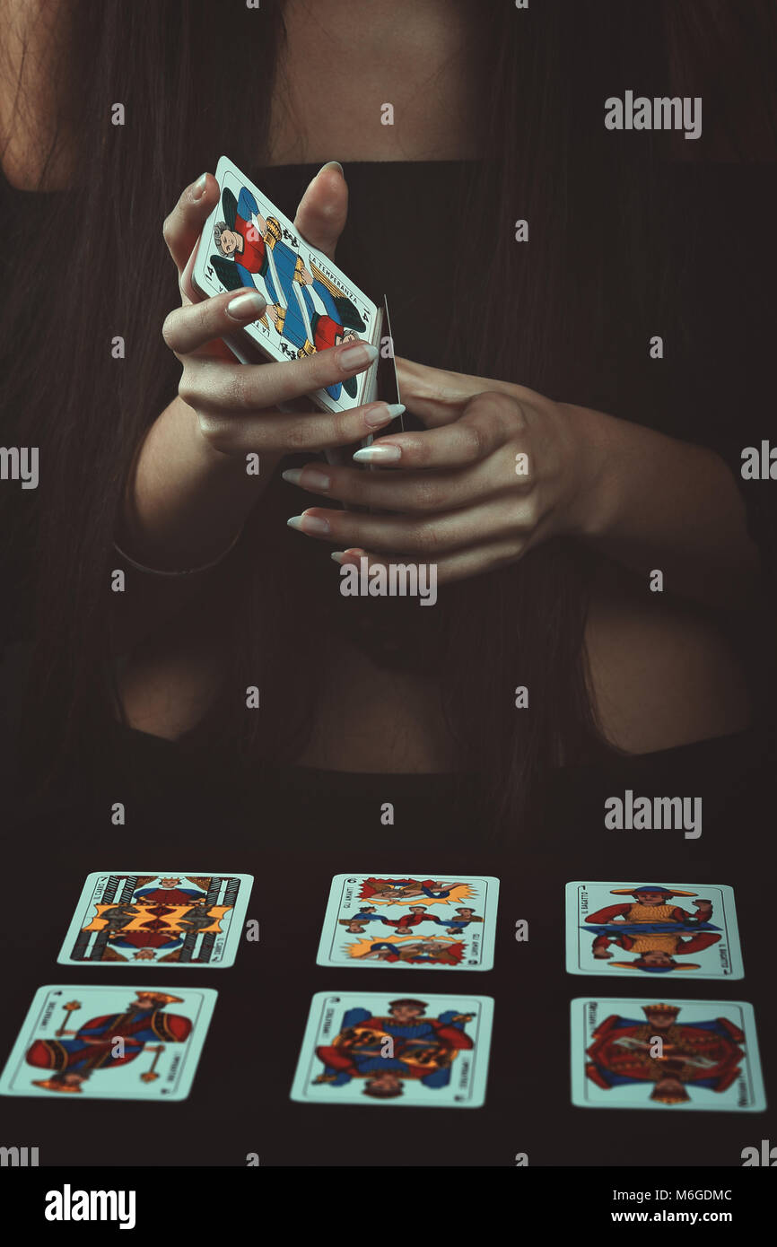 Hands with tarot cards. Fortune telling - Stock Image