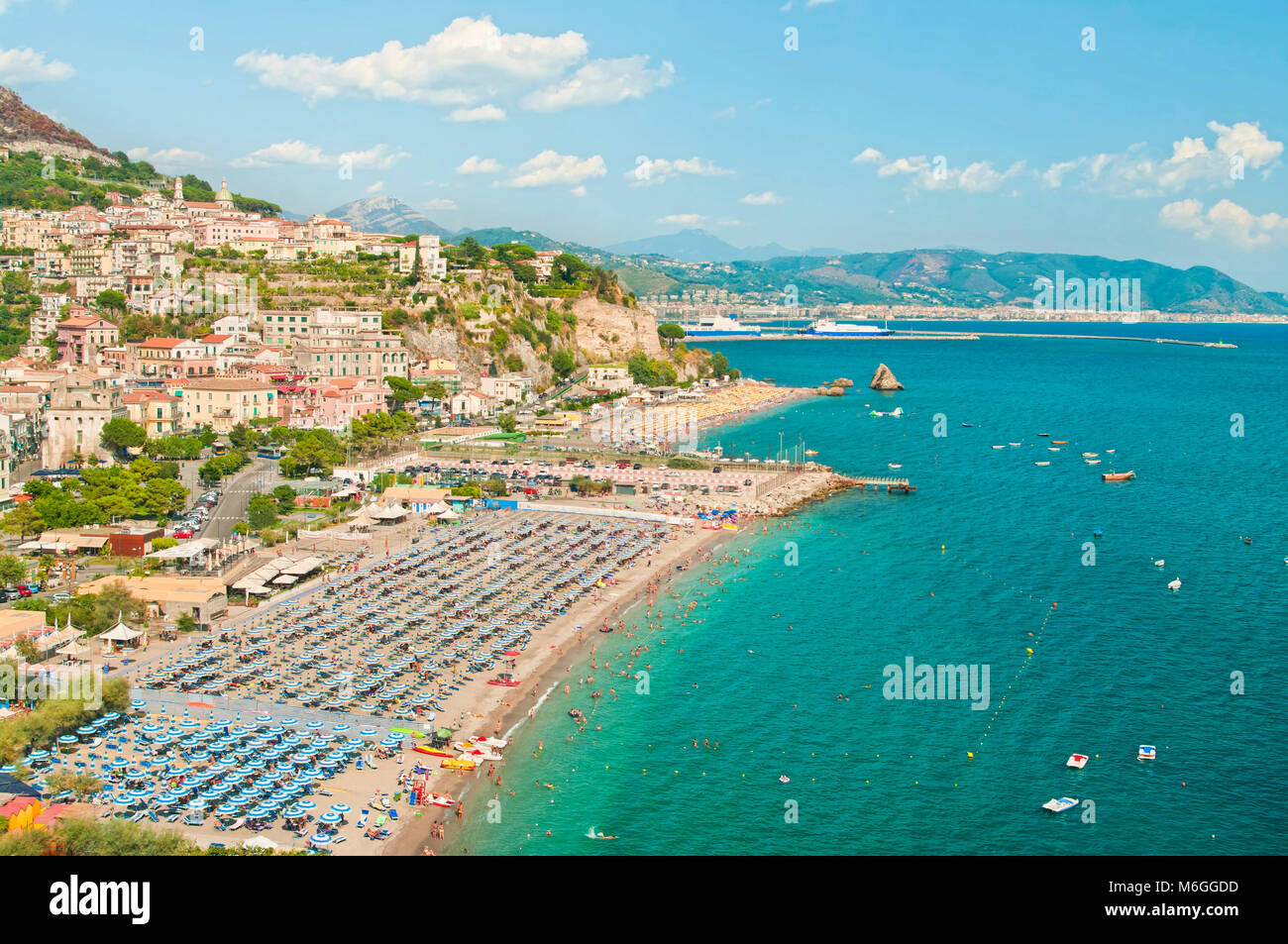 aerial view of Vietri Sul Mare beach with people on sunny summer day with mountains at background, Amalfi coast, Stock Photo