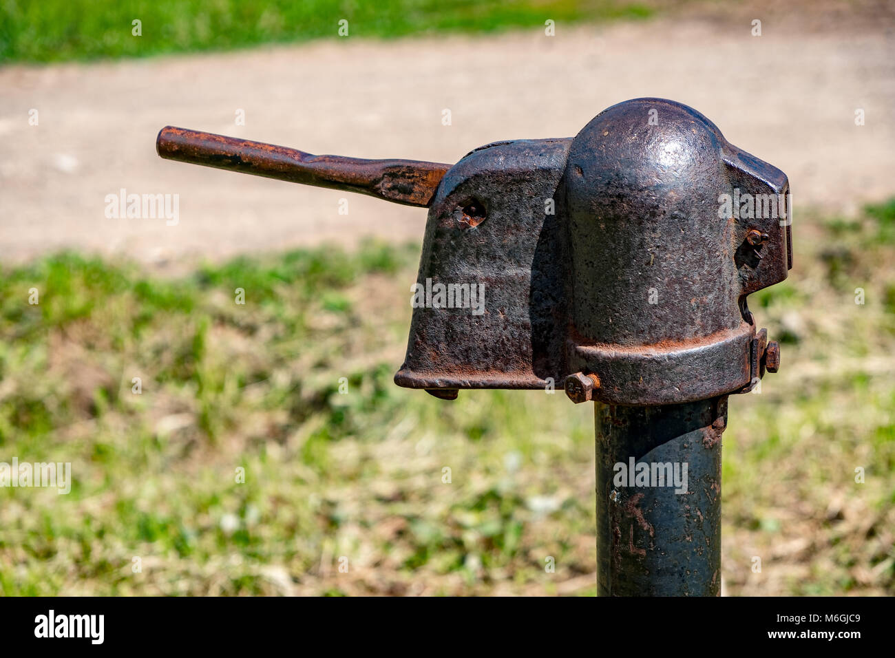 Old water pump with rusty lever in the village Stock Photo ...