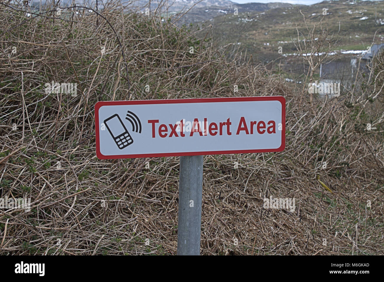 Text Alert sign on the side of a road, where locals can get texts from the police of local crime if they register - Stock Image