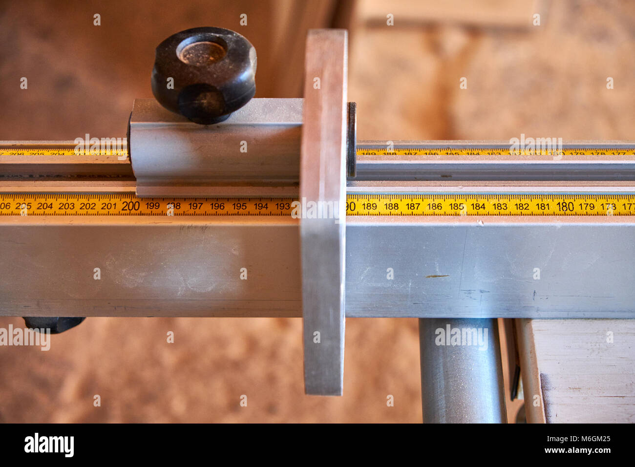 Measuring scale with a stopper on the panel squaring saw - Stock Image
