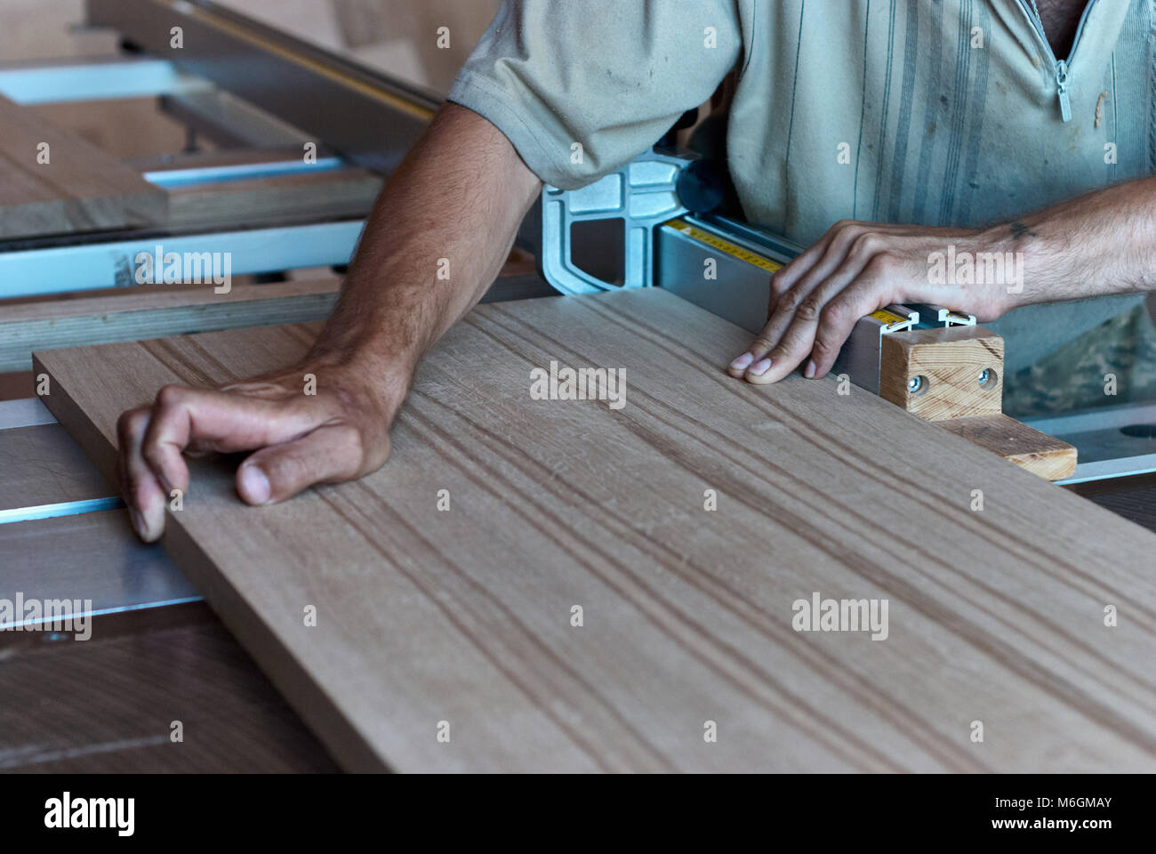 Panel squaring saw before sawing a thick edged oak board - Stock Image