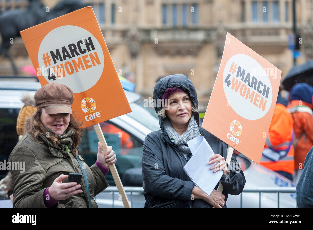 London, UK.  4 March 2018.  Women carry placards during the march. Hundreds of men and women take part in the annual - Stock Image