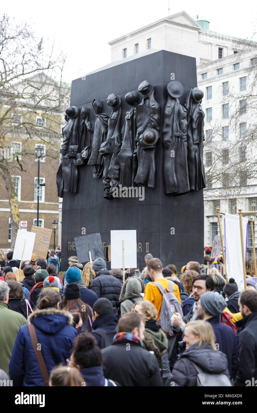 Westminster, London, 4th March 2018. Protesters walk past the women of WW2 memorial monument in Whitehall. Thousands - Stock Image