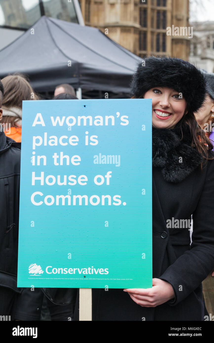 Westminster, London, 4th March 2018. Thousands of placard-bearing women and men walk through London for the annual - Stock Image