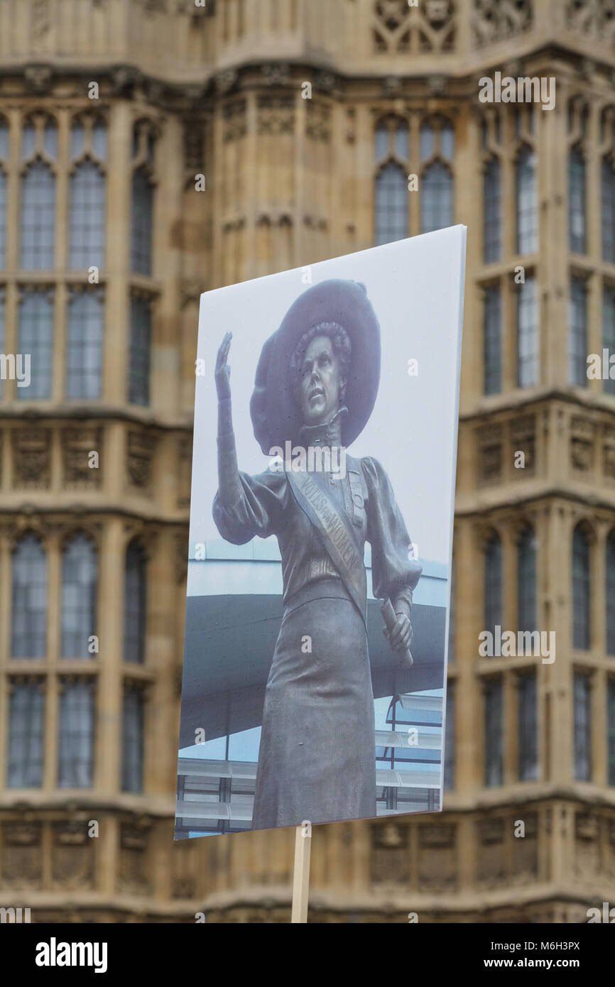 Westminster, London, 4th March 2018. A picture of Alice Hawkins, one of the suffragettes, is carried through Westminster - Stock Image