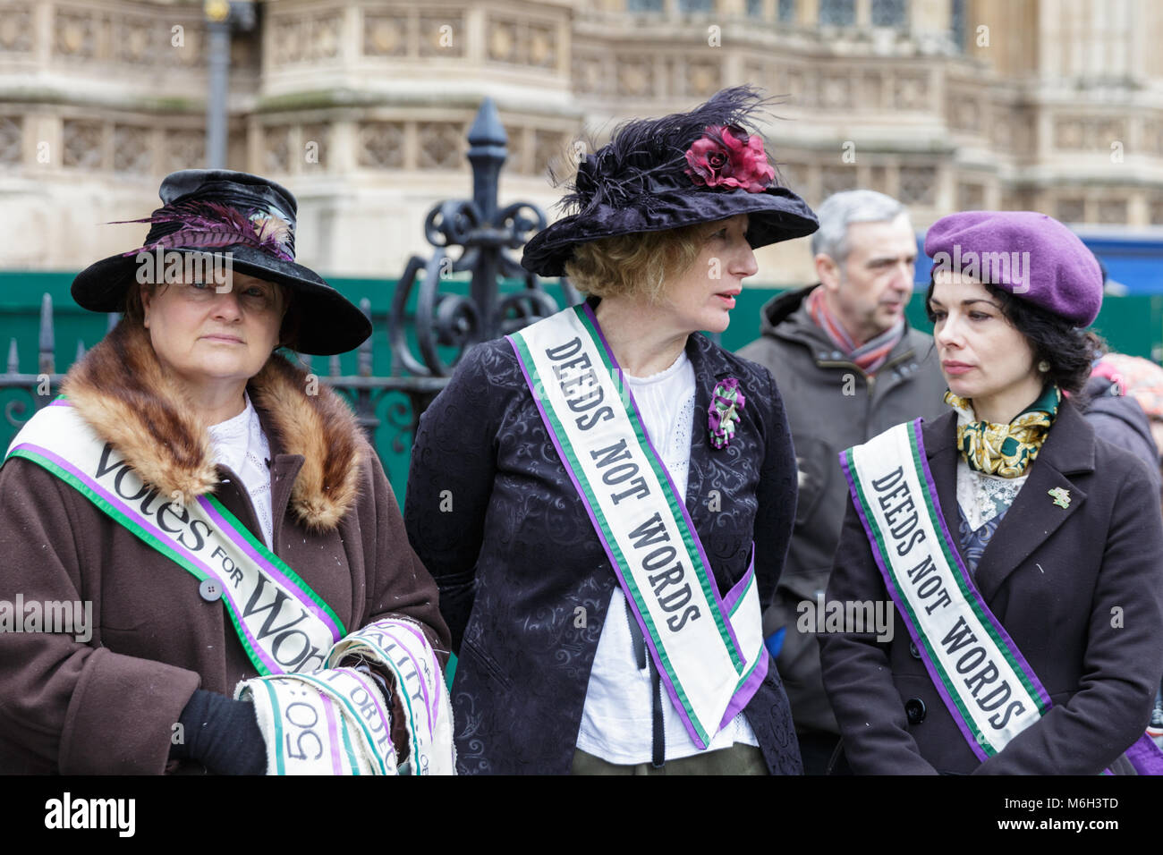 Westminster, London, 4th March 2018. A group of women in suffragettes' outfits. Thousands of placard-bearing - Stock Image