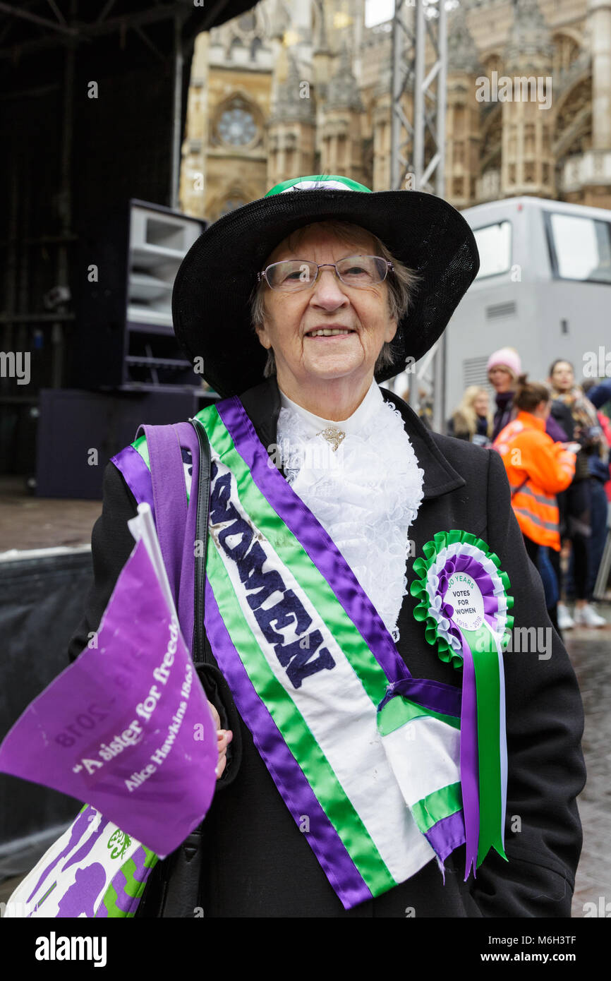 Westminster, London, 4th March 2018. A woman in suffragette's outfit. Thousands of placard-bearing women joins - Stock Image