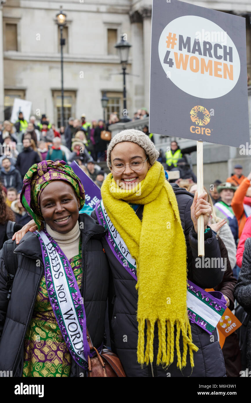 Westminster, London, 4th March 2018. Thousands of placard-bearing women joins and men walk through London for the - Stock Image