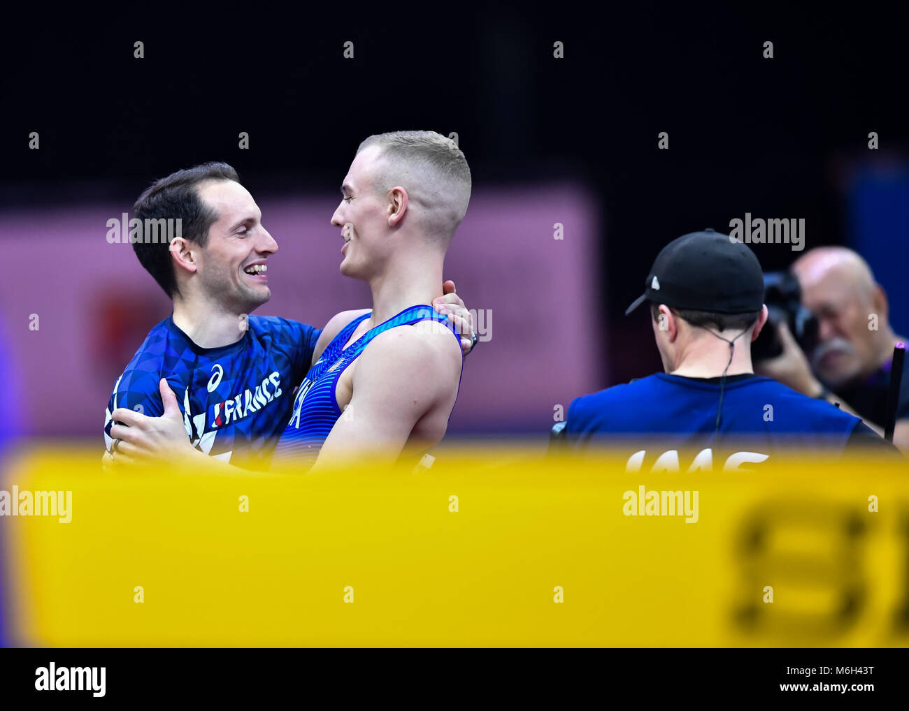 Birmingham, UK. 4th Mar, 2018. Axel Chapelle (FRA) was congratulated by Sam Kendricks (USA) for winning the Men's - Stock Image