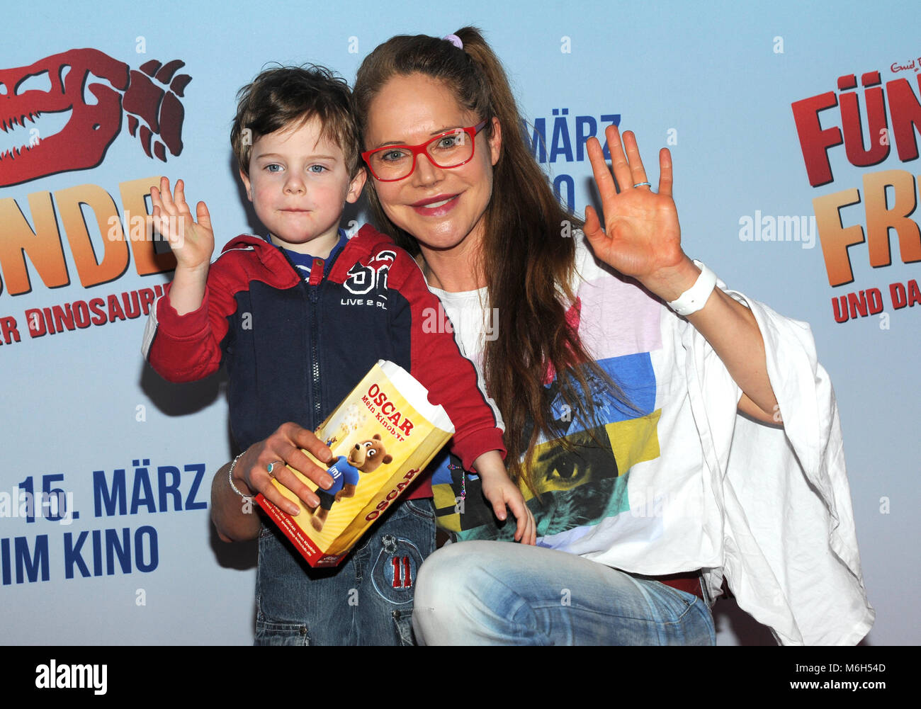 04 March 2018, Germany, Munich: Actress Doreen Dietel and her son Marlow arriving at the premiere of 'Fünf - Stock Image