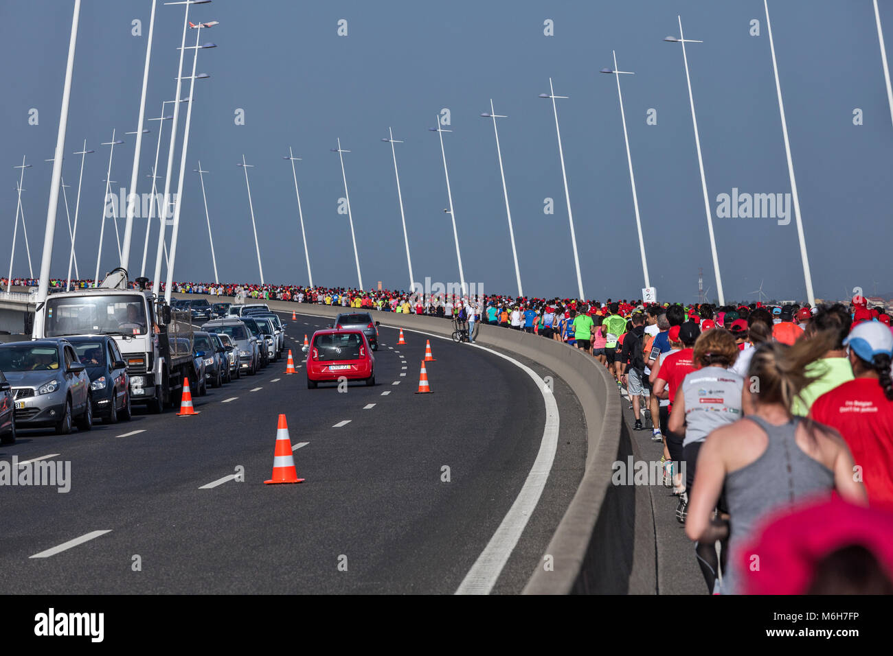 Runners on Vasca da Gama bridge at Lisbon Rock'n'Roll marathon 2017 - Stock Image
