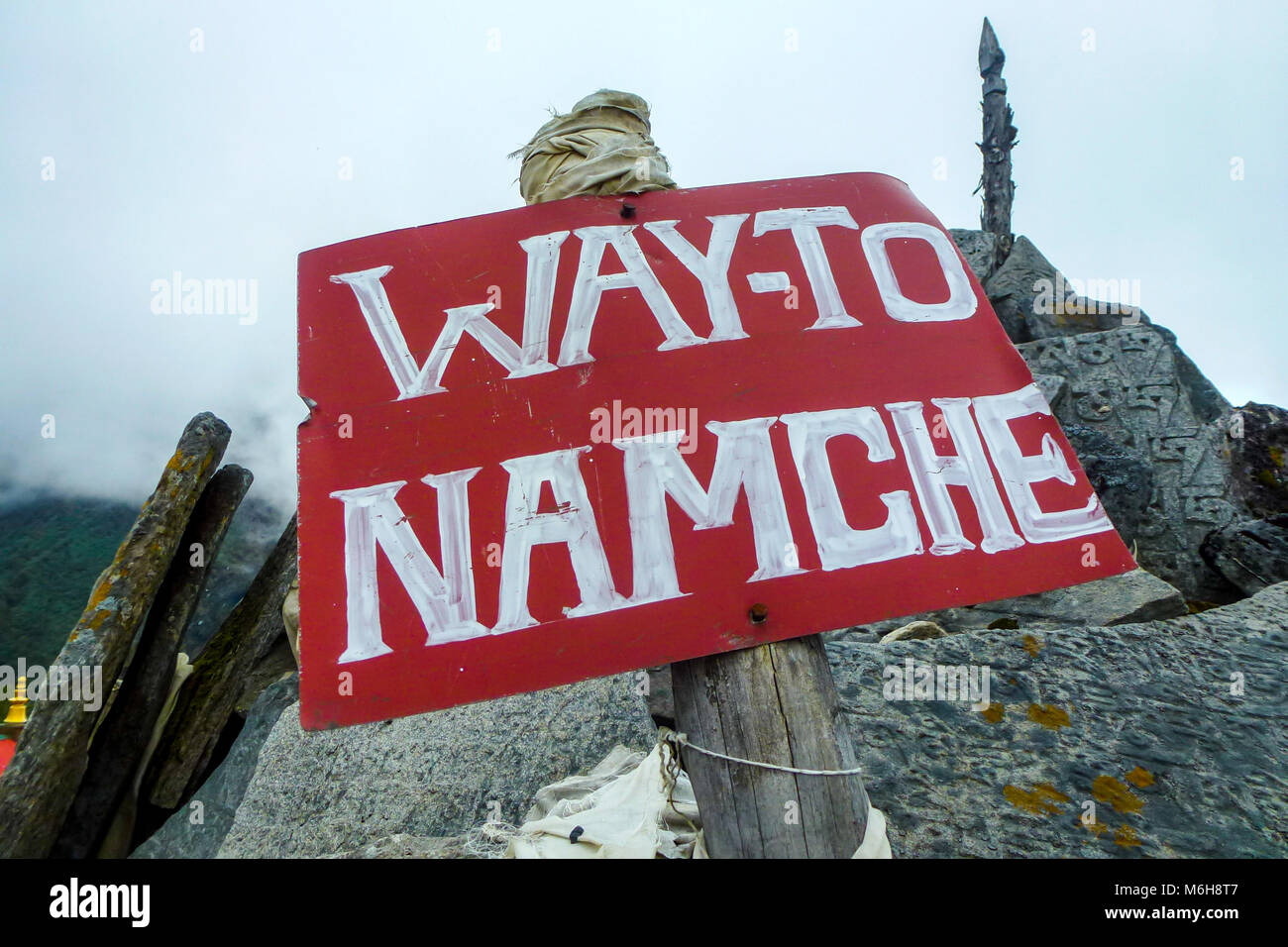 Red sign to Namche Bazaar, Tengboche monastery, Everest Base Camp trek, Nepal - Stock Image