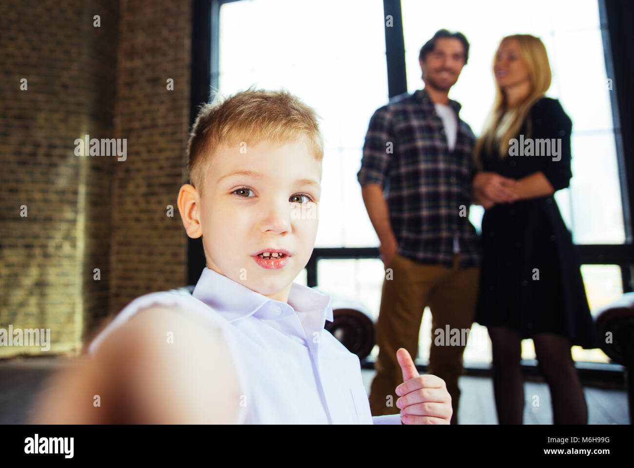 Family home portrait. Parents and son spending time together Stock Photo