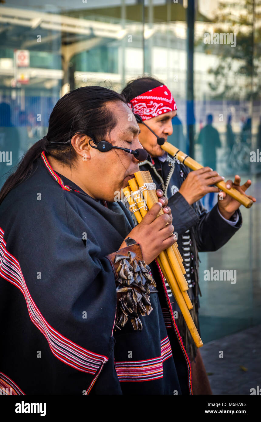 LONDON, UK - OCT. 15, 2017: Native American Men In traditional native costume playing flute. Street Musicians at - Stock Image