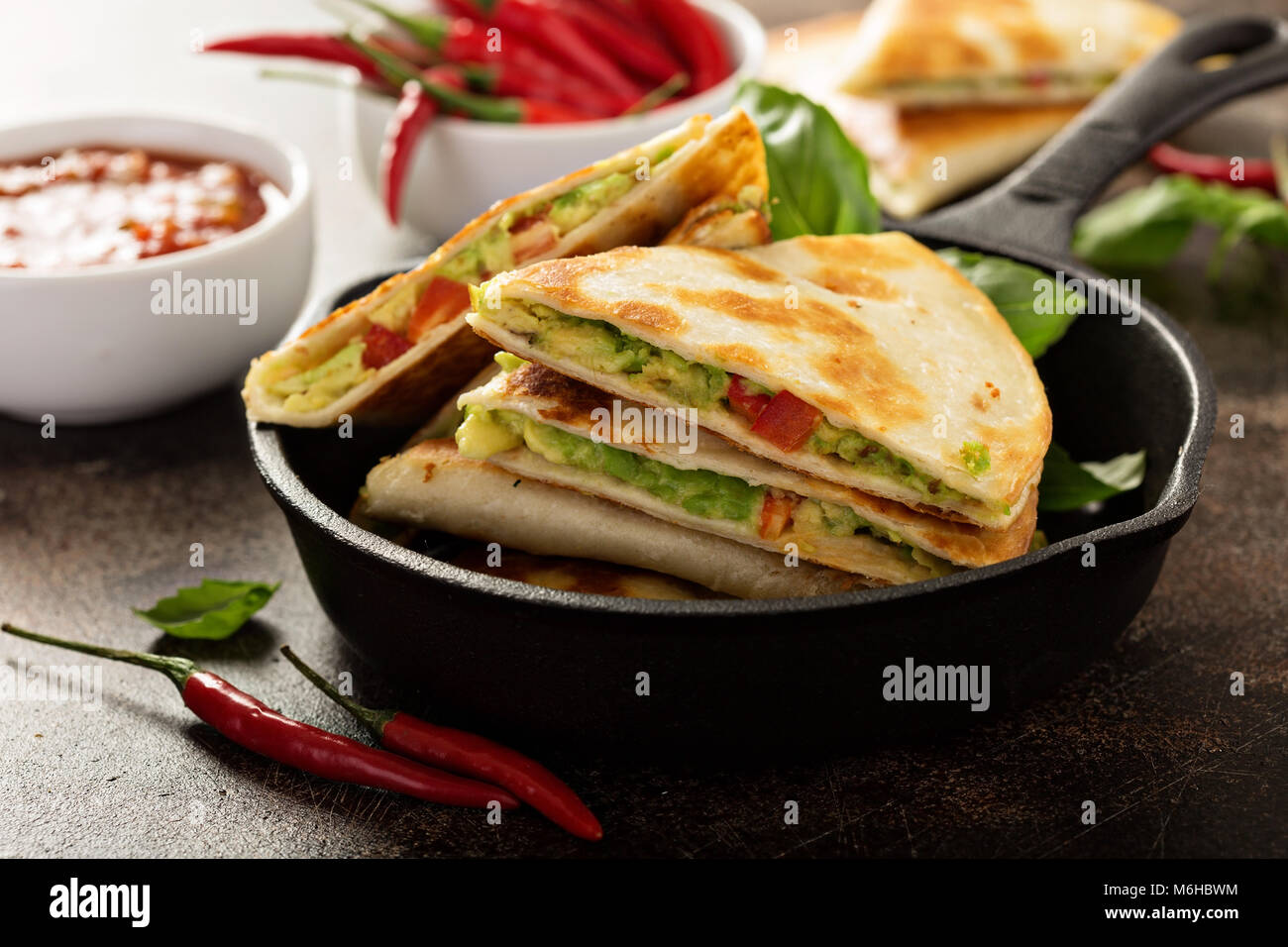 Vegan quesadillas with avocado and red peppers - Stock Image