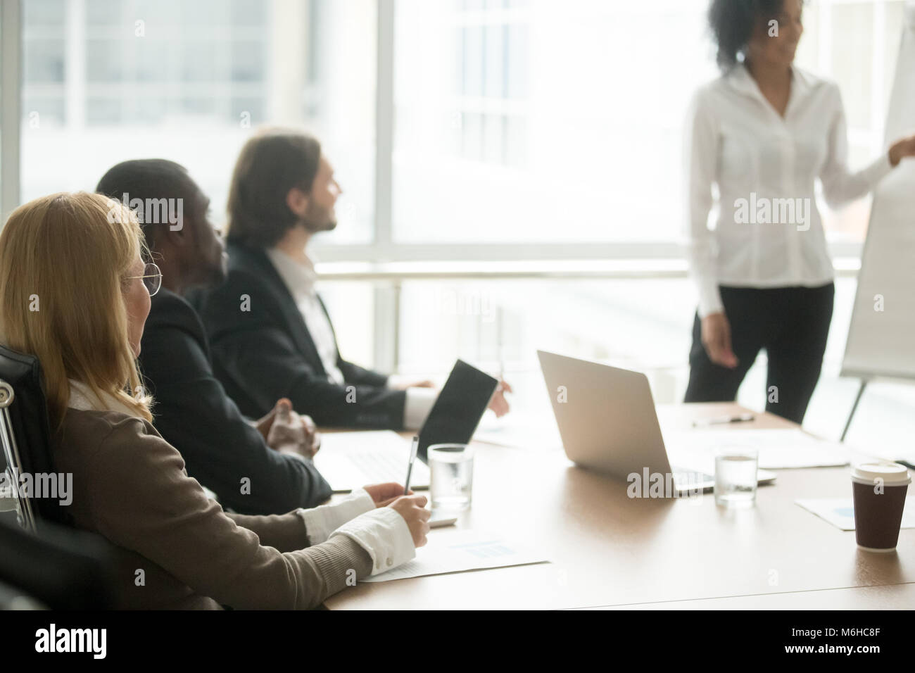 Multiracial businesspeople attending corporate group training or - Stock Image