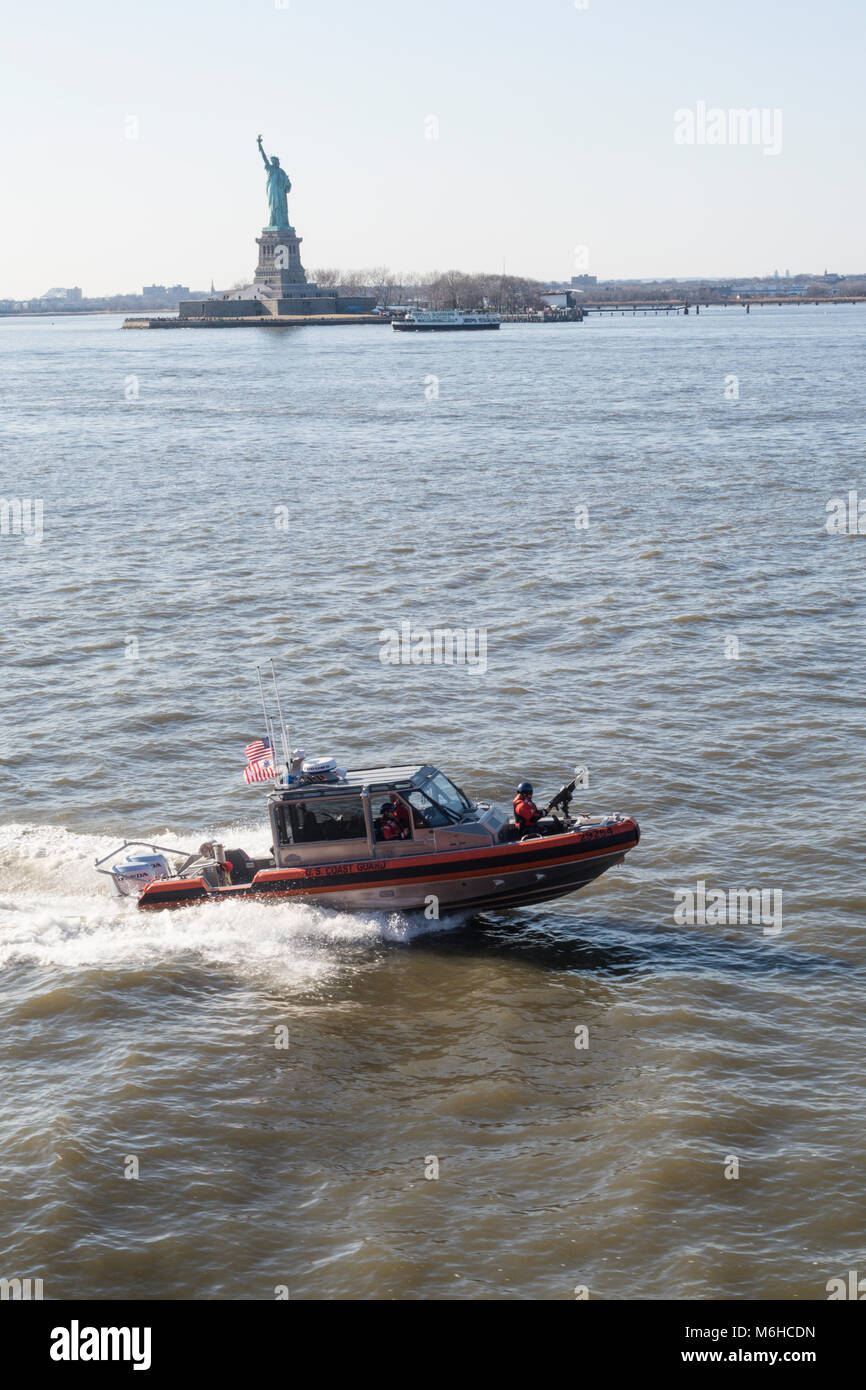 U.S. Coast Guard Patrol Boat Operates in New York Harbor, NYC, USA - Stock Image