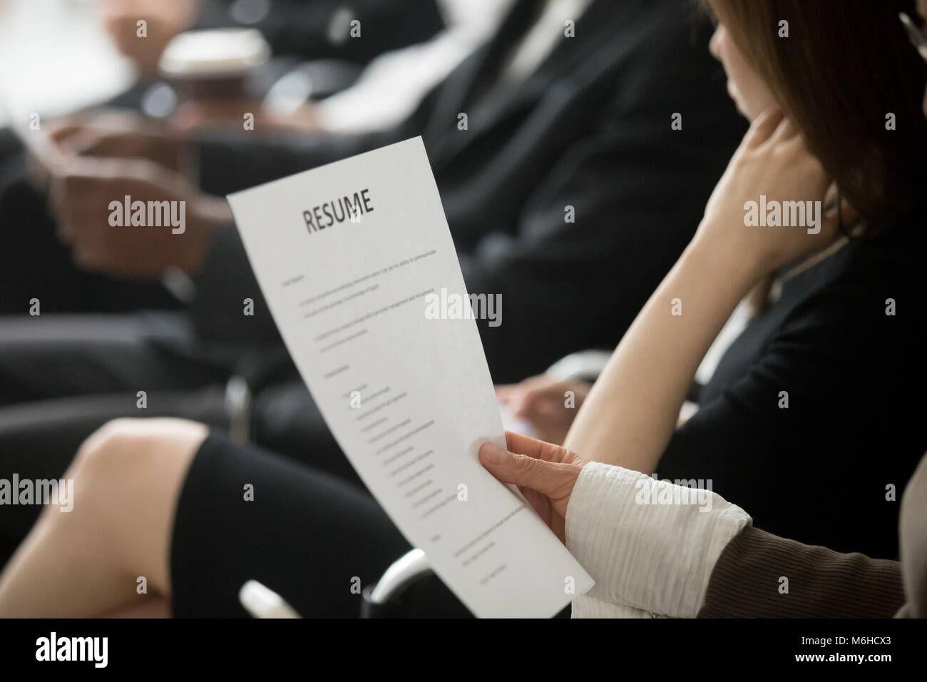 Multiracial business people waiting in queue preparing for job i - Stock Image