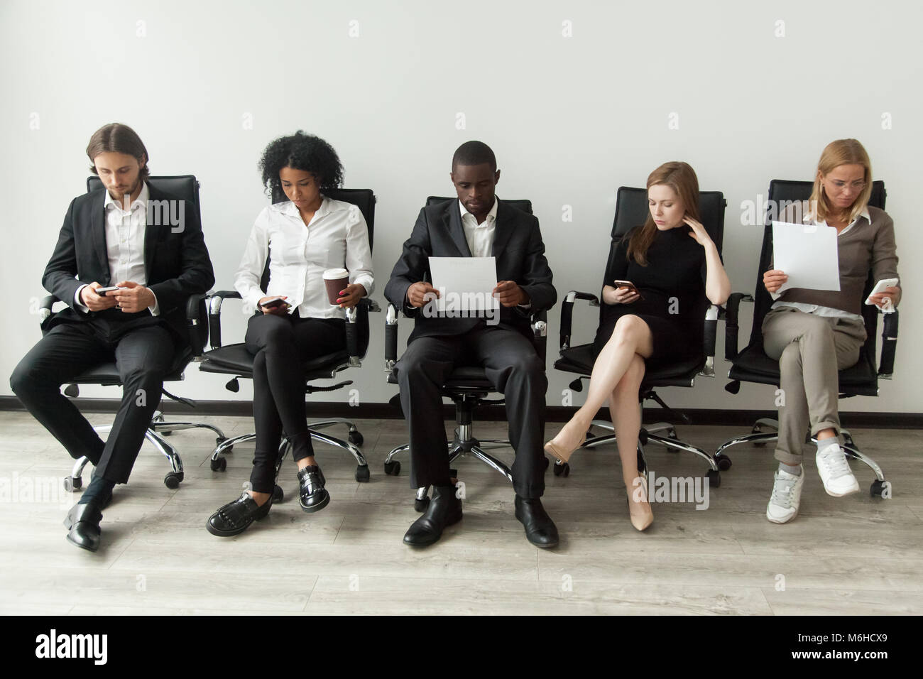 Nervous stressed job applicants preparing for interview waiting  - Stock Image