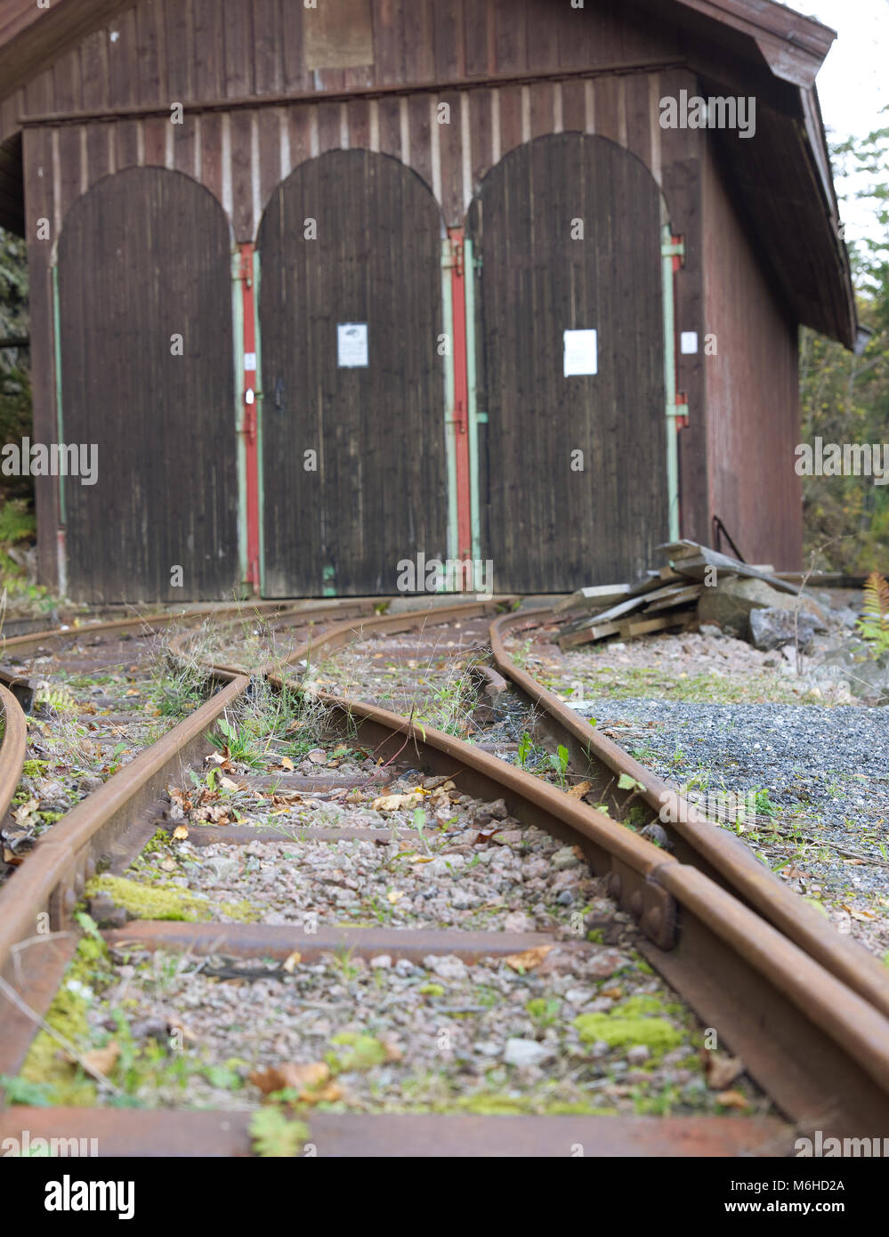 Rail tracks leading up to a train garage at Konnerud Mining Museum in Norway - Stock Image