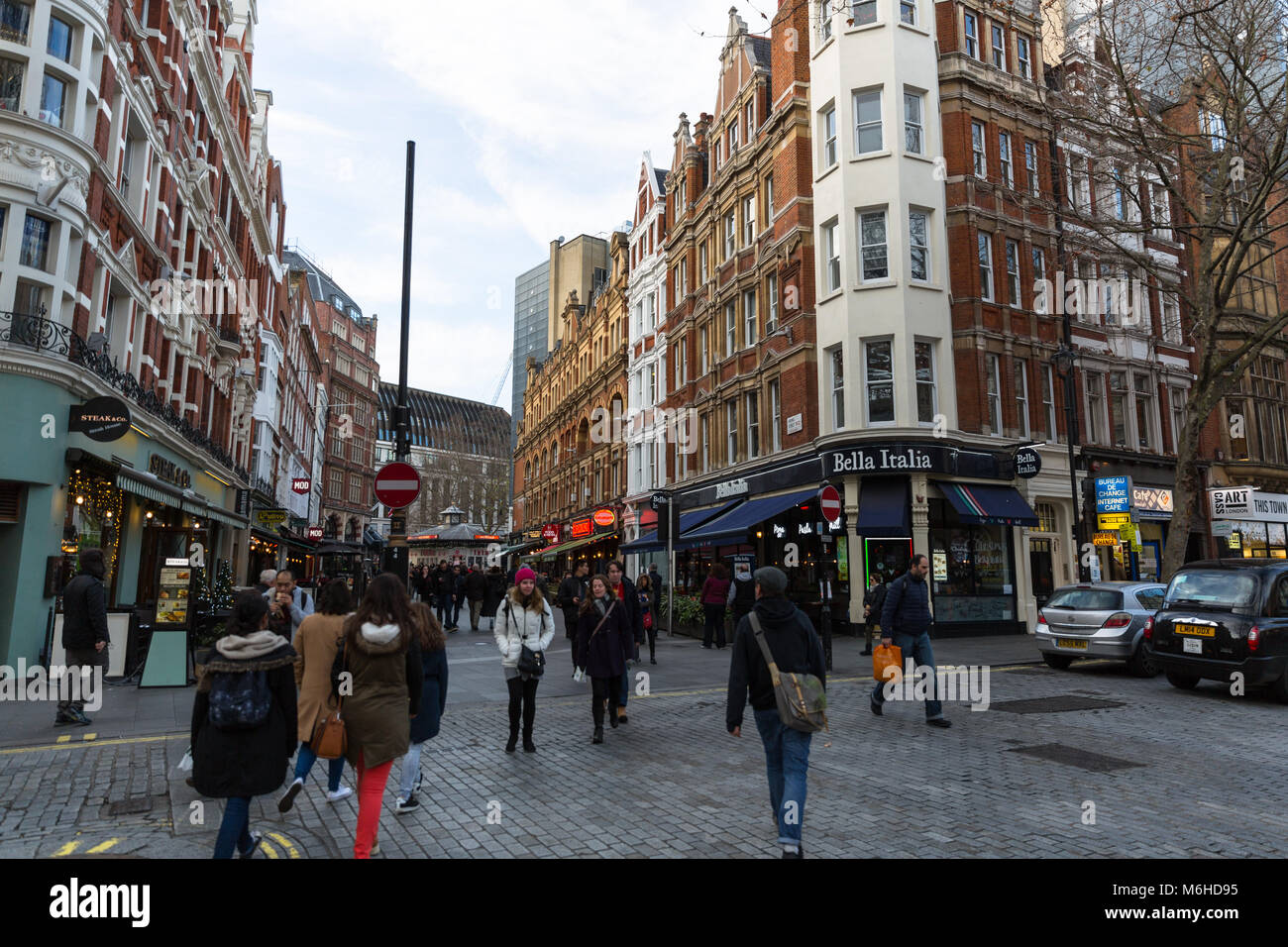 View of buildings and people outside Leicester Square - London, England - UK - Stock Image