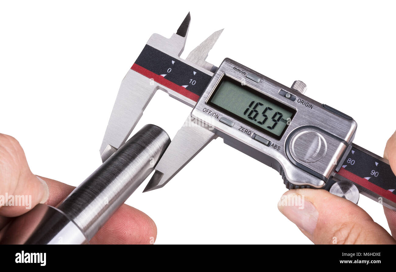 Accuracy measuring of steel part by digital calipers. Detail of worker's hands with digital tool and metal morse - Stock Image