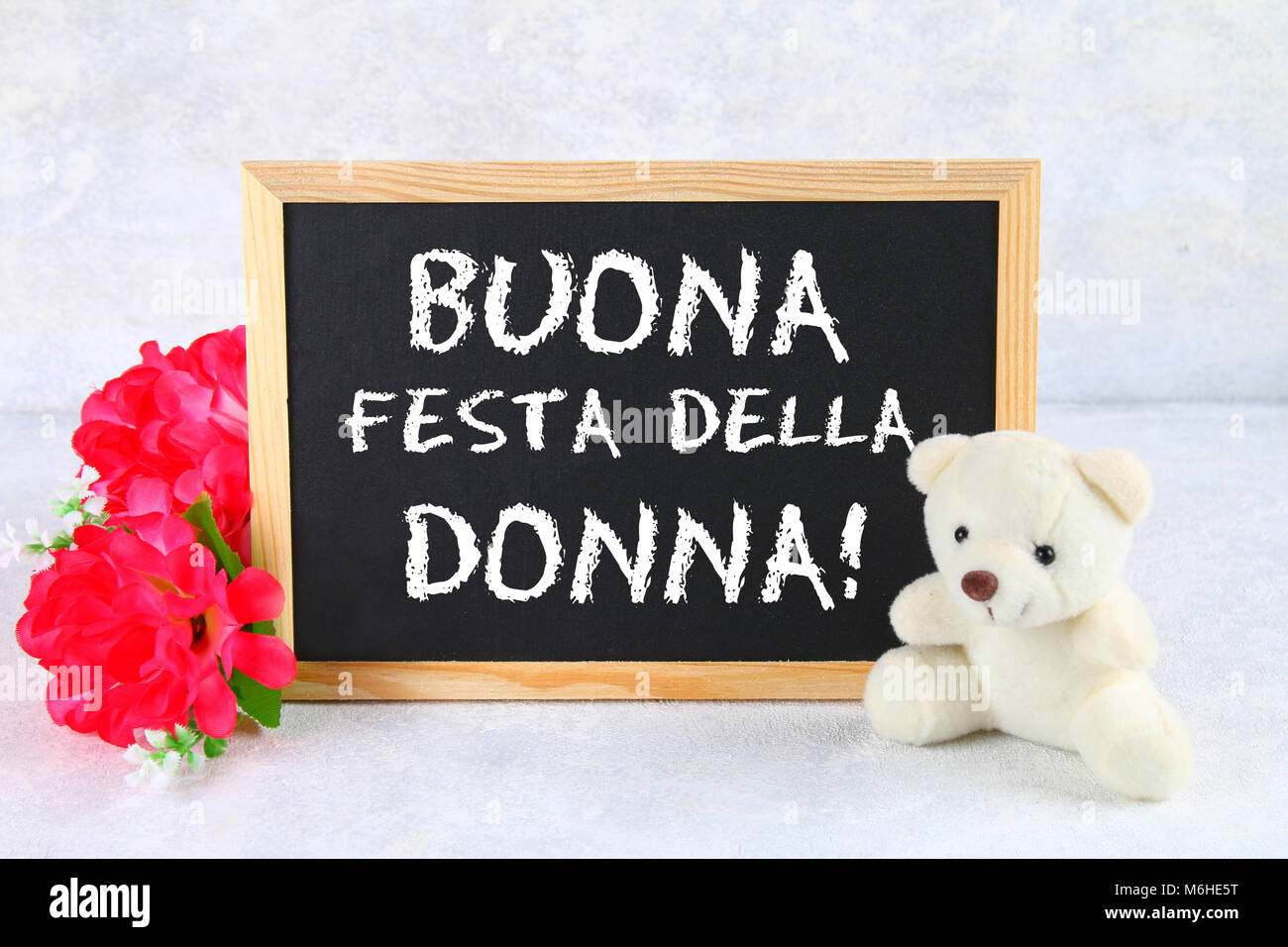 The Inscription On Chalkboard In Italian Happy Womans Day Pink Flowers And Teddy