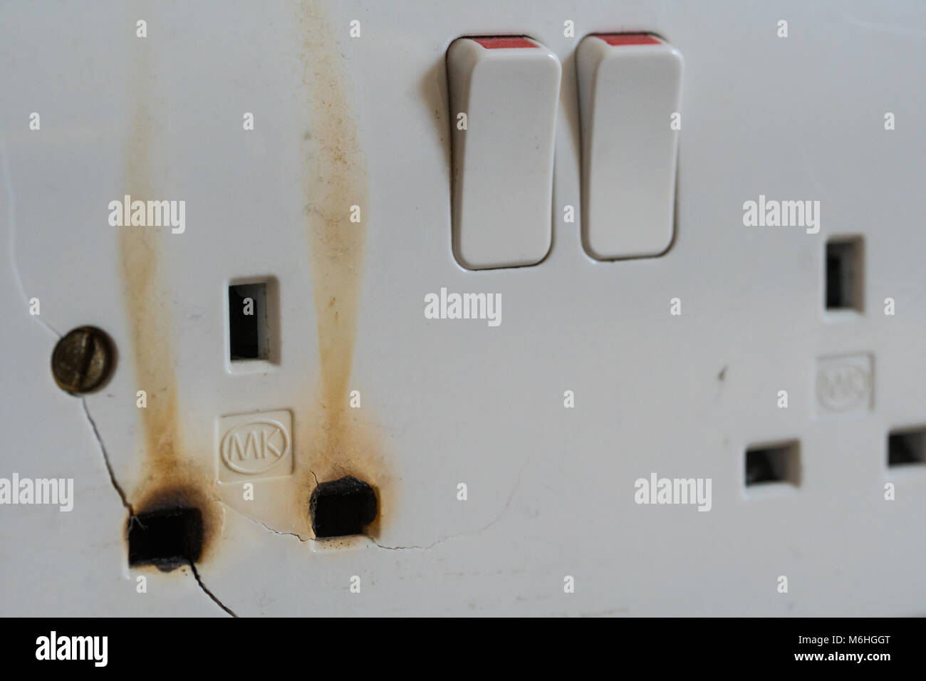 A Burnt Out Electrical Wall Socket Caused By Overloading With Too M Hggt