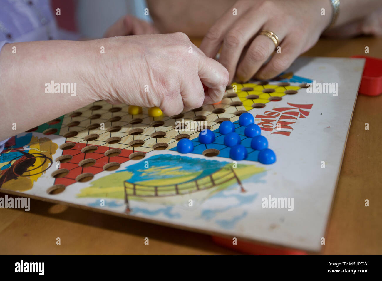 Woman playing china chess, Upplands Väsby, Sweden. Stock Photo