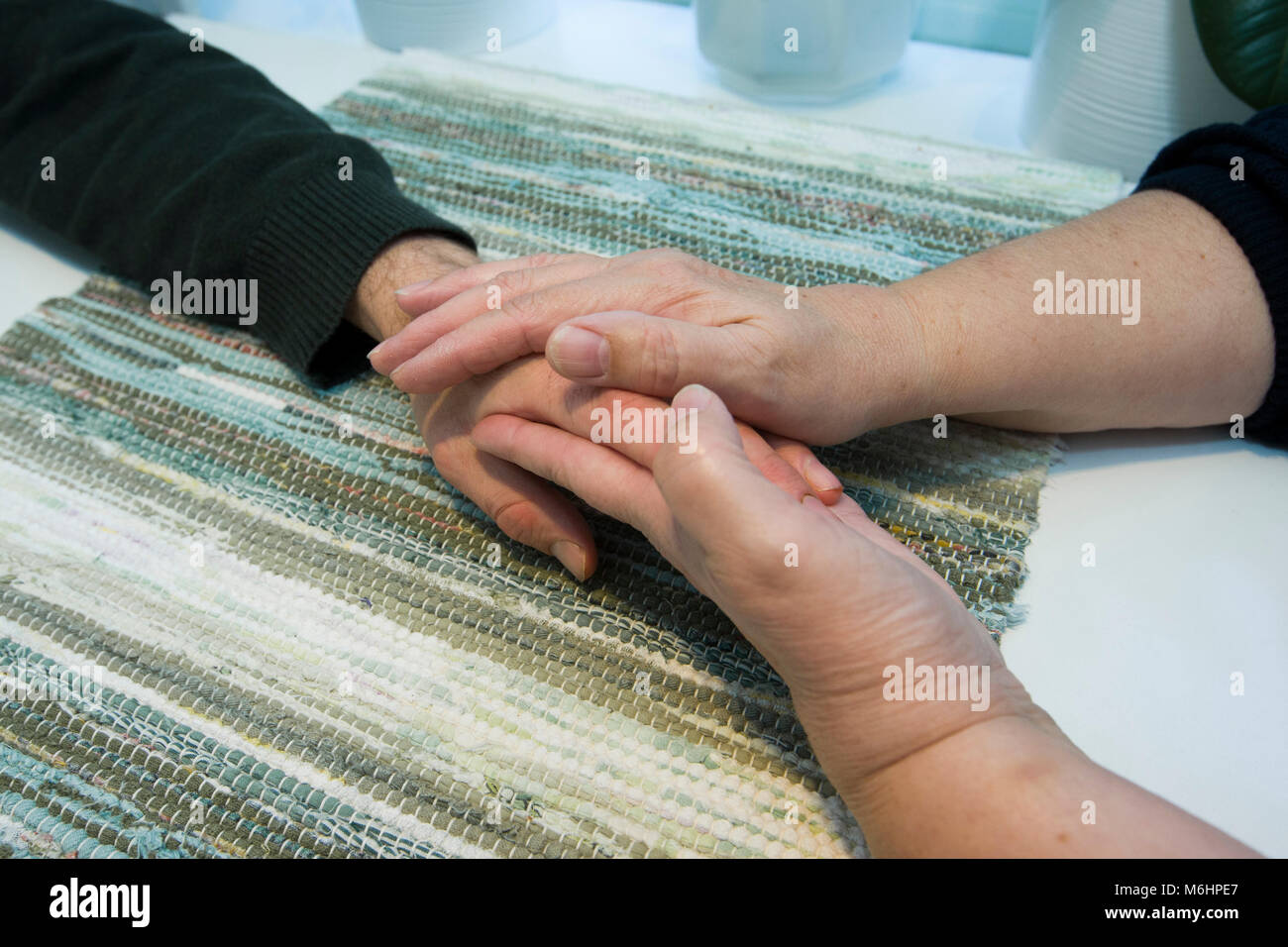 A helping hand when someone needs human proximity, Upplands Väsby, Sweden. - Stock Image