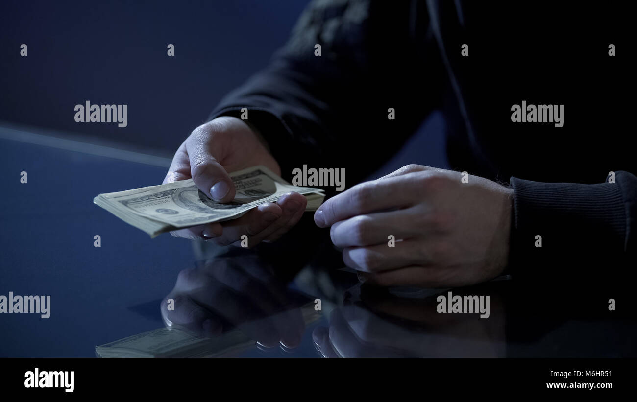 Male hands holding money, illegal payments, cash for contract killing closeup - Stock Image