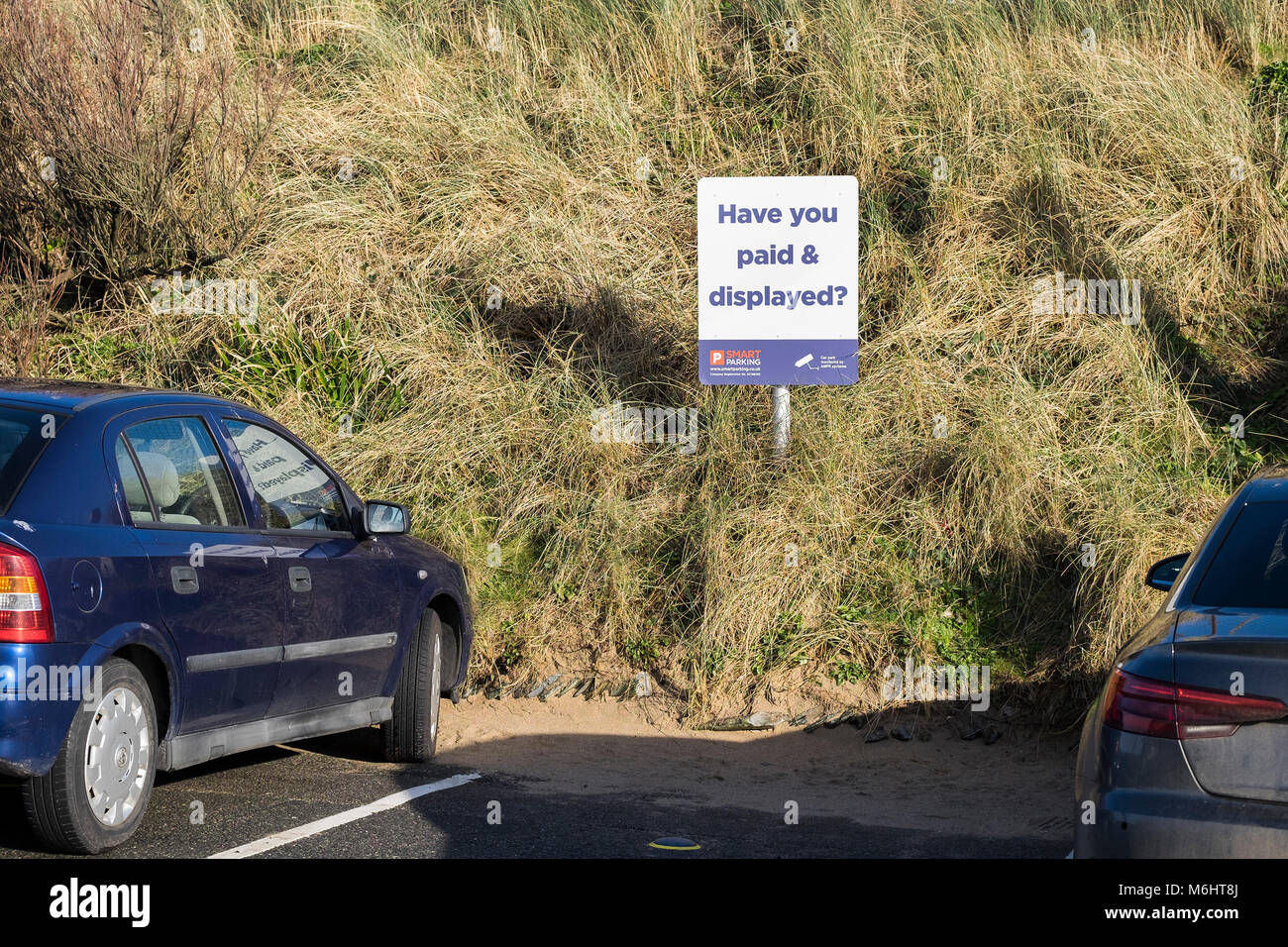 A parking sign owned by Smart Parking in Fistral Beach car park in Newquay Cornwall. - Stock Image