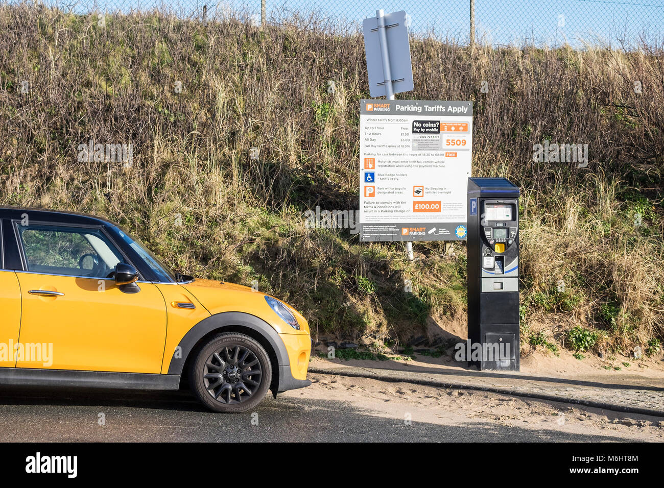 Car parking payment machine owned by Smart Parking Company at Fistral Beach car park newquay Cornwall. - Stock Image