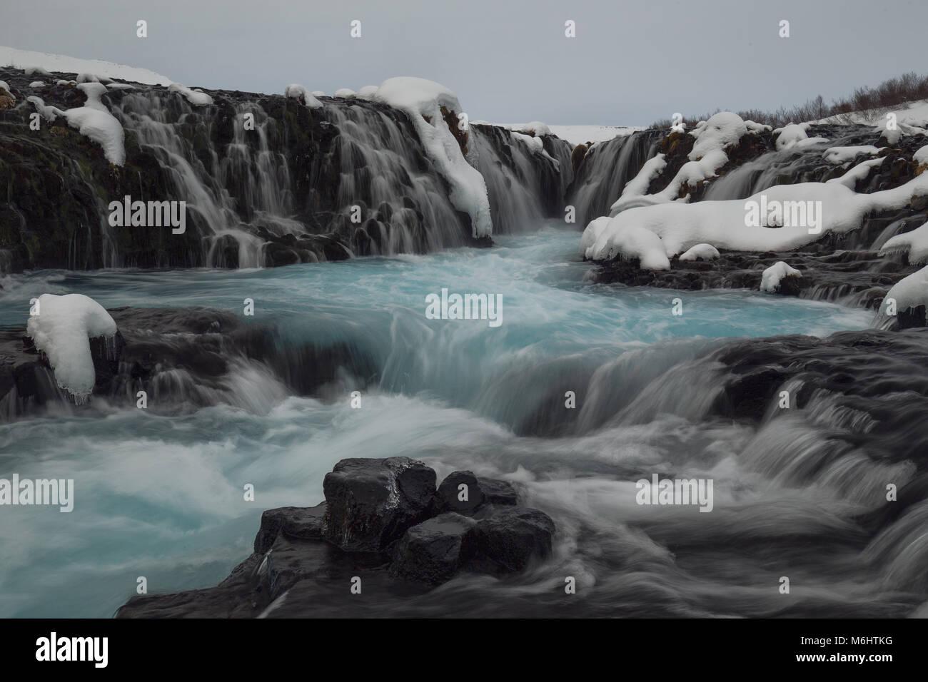 Inside Bruearfoss blue waterfall in Iceland - Stock Image