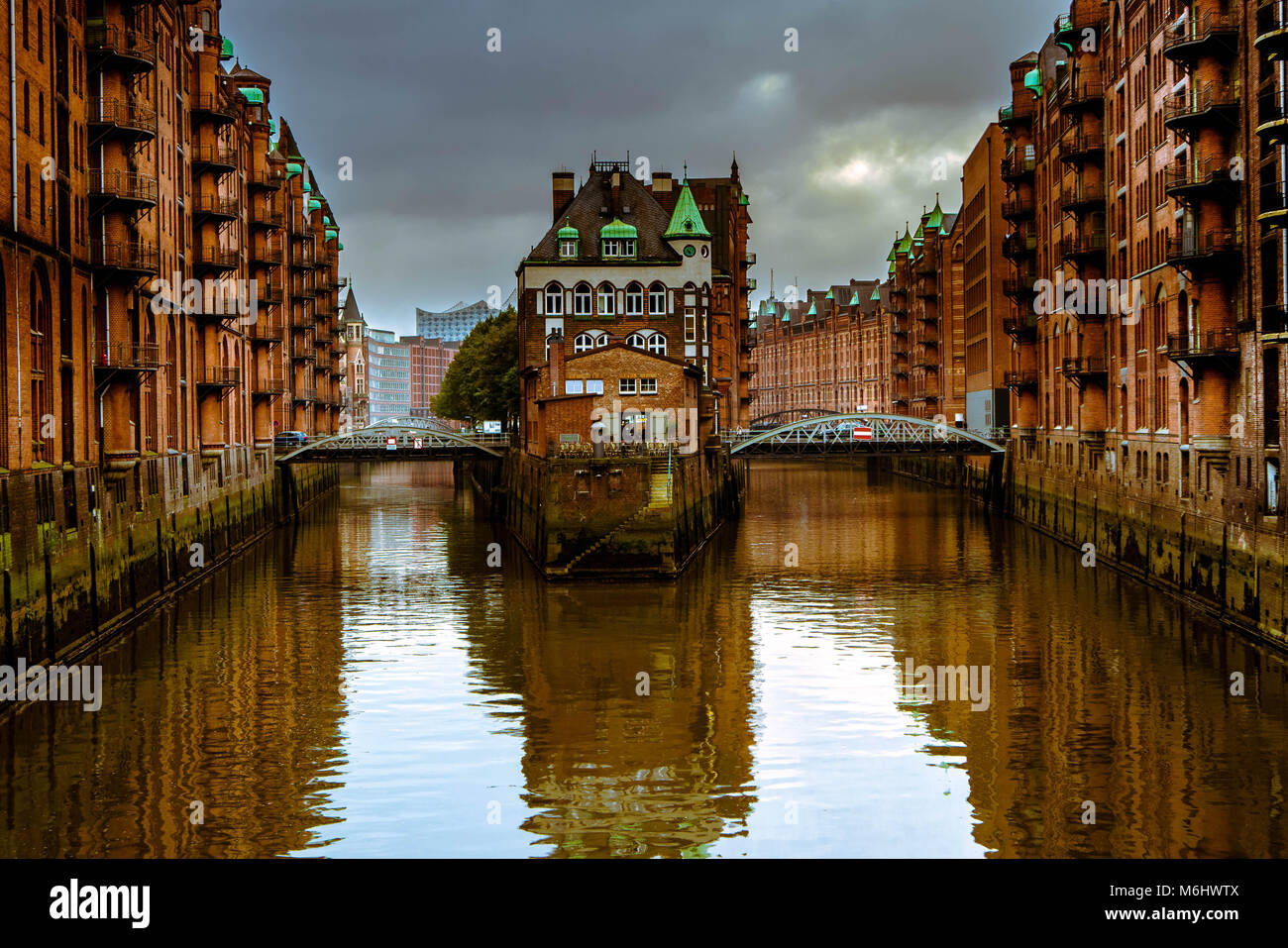 Historical buildings and canal in the Speicherstadt in Hamburg, Germany - Stock Image