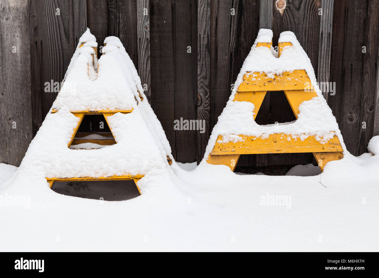 Yellow A-frame barrier supports covered in fresh snow Stock Photo ...