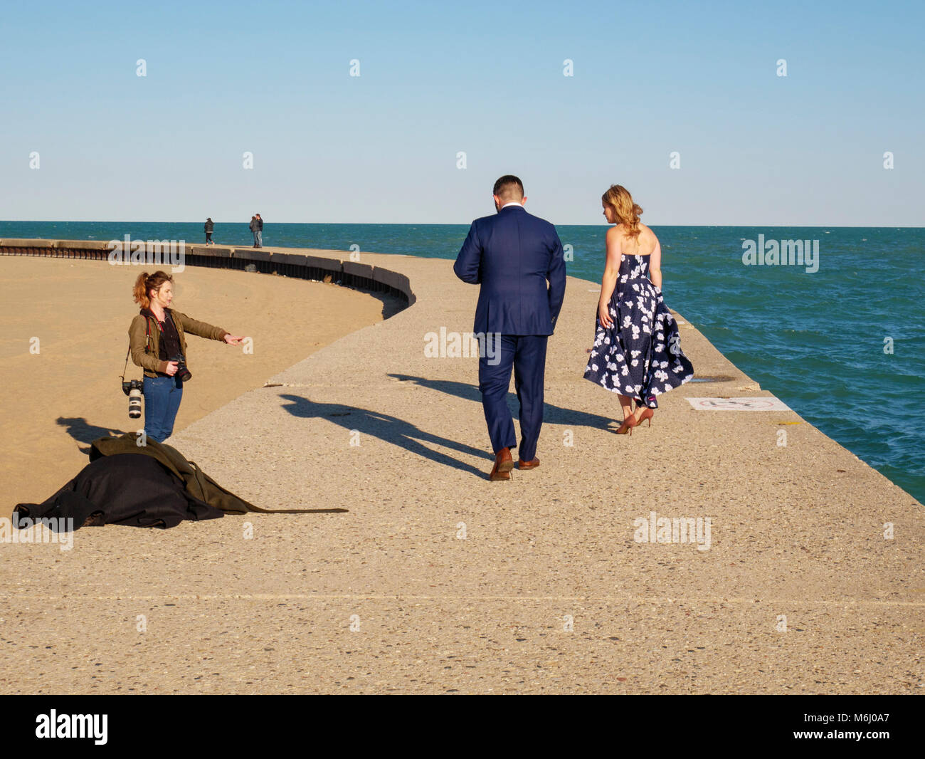 Engagement photo shoot on the sea wall at North Avenue Beach. Chicago, Illinois. - Stock Image
