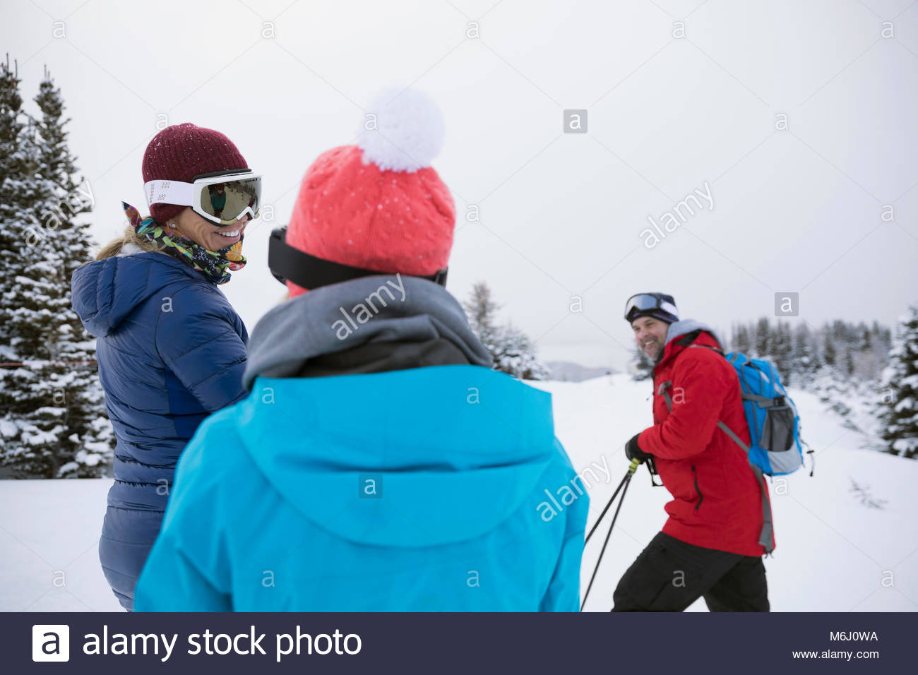 Family snowshoeing in snow - Stock Image