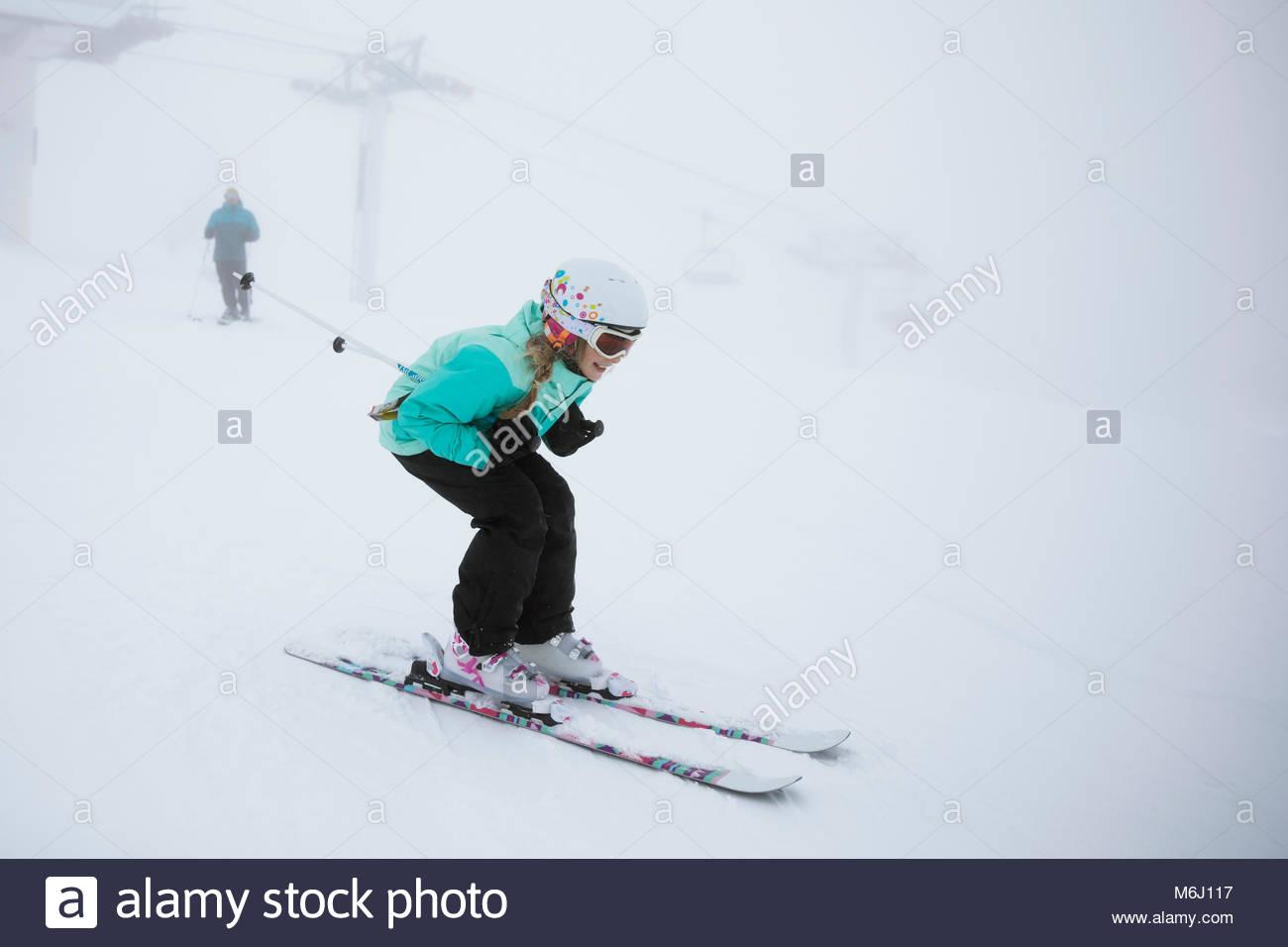 Girl skier skiing in snow - Stock Image