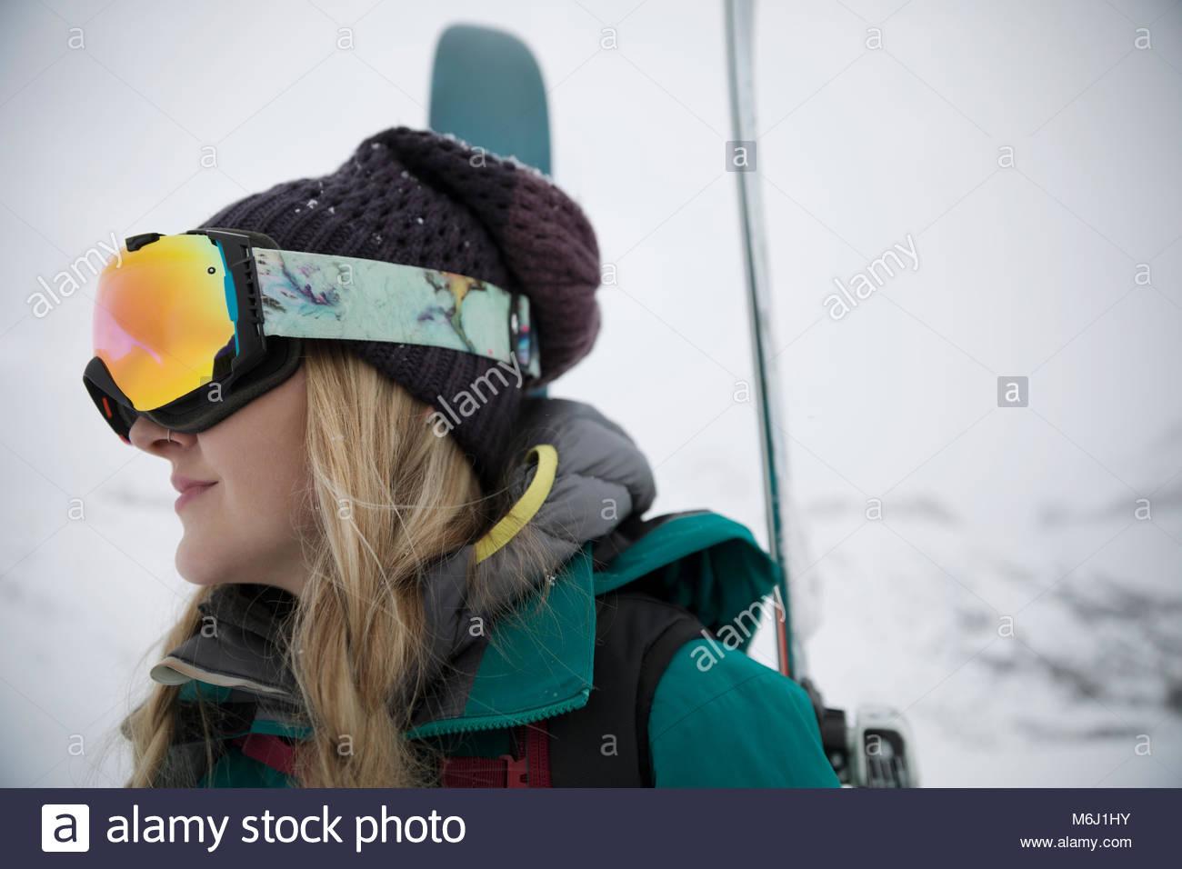Female skier in ski goggles - Stock Image